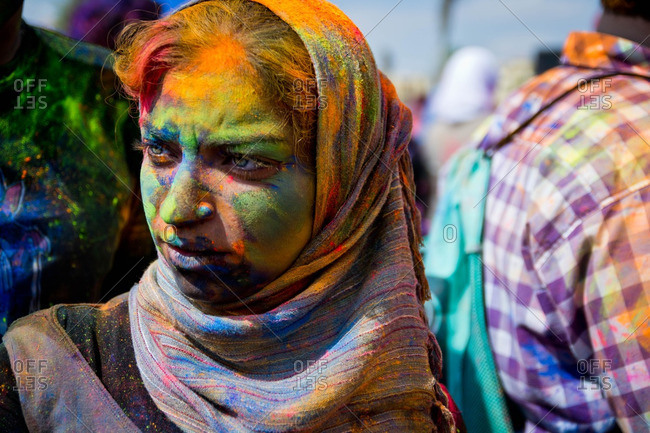 Cairo, Egypt - October 15, 2011: Woman covered in bright colored powder at a color festival