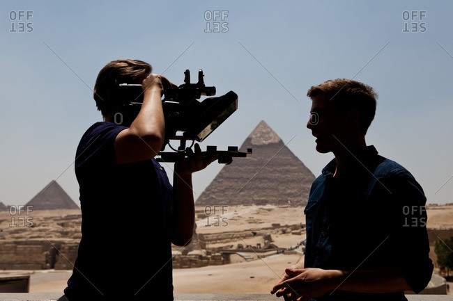 Cairo, Egypt - June 24, 2014: Men filming in front of the Pyramid of Khafre