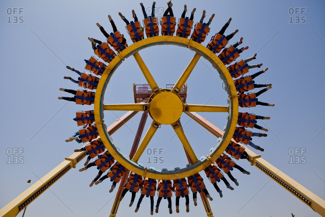 Cairo, Egypt - May 17, 2014: Low angle view of a ride filled with people at the Dream Park amusement park in Egypt
