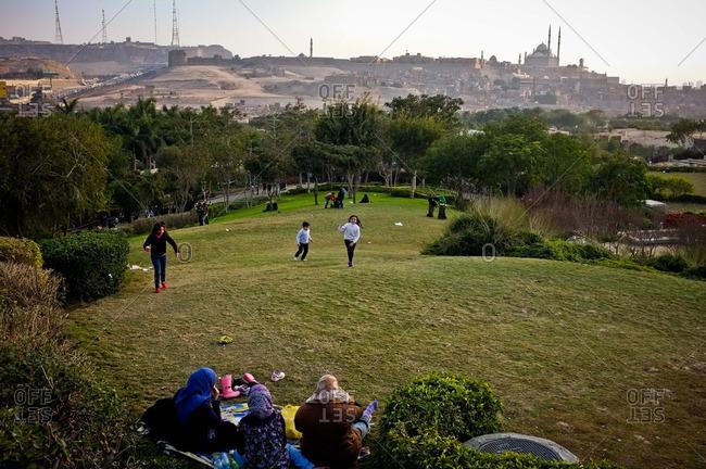 Cairo, Egypt - January 14, 2013: People in Al-Azhar Park overlooking Cairo