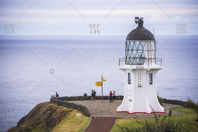 Cape Reinga, New Zealand - February 21, 2015: Cape Reinga Lighthouse (Te Rerenga Wairua Lighthouse), Aupouri Peninsula, Northland, North Island, New Zealand, Pacific