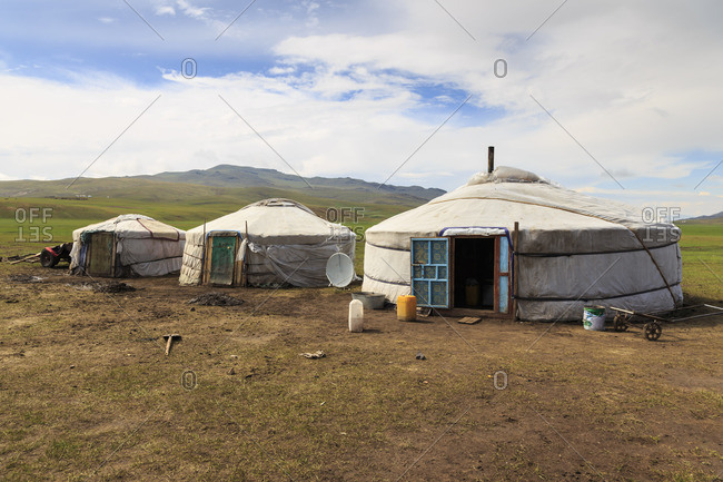Line of family gers at a Summer nomad camp, distant gers and mountains, Khujirt, Uvurkhangai (Ovorkhangai), Central Mongolia, Central Asia, Asia