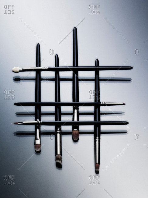 Makeup brushes arranged in pattern
