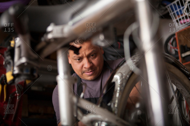 Mechanic at work in bicycle shop