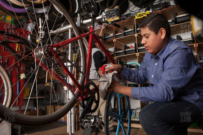Profile of a mechanic working in bicycle shop