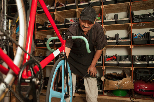 Mechanic fixing tire in a bicycle shop