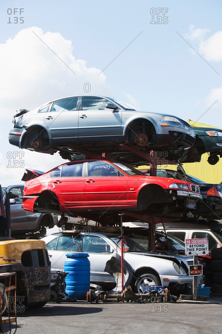 New York City, NY, USA - March 7, 2013: Cars stacked in a junk yard