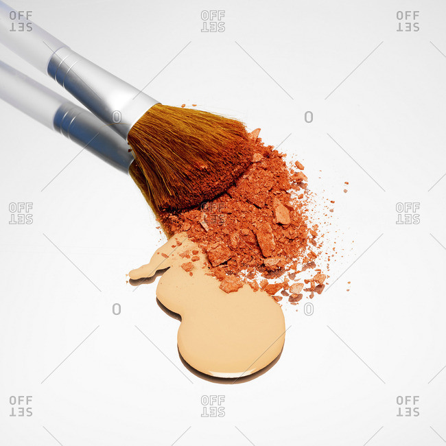 Foundation and blusher with make up brush