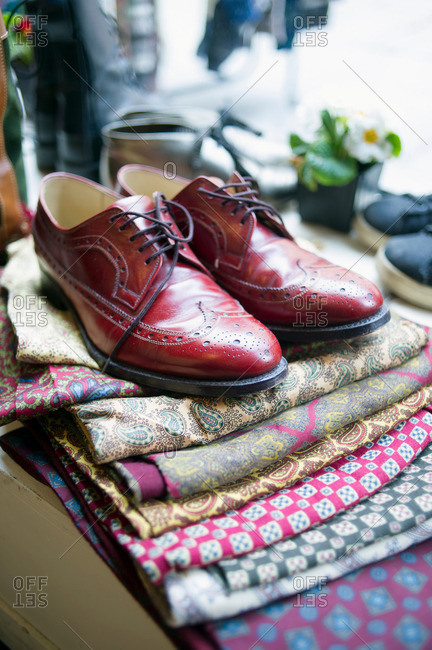 Vintage men's shoes on top of pile of fabric