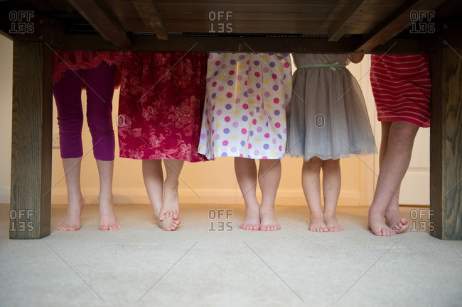 Girls standing together with barefeet in a row, low section