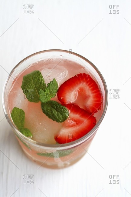 A strawberry mojito with mint leaves