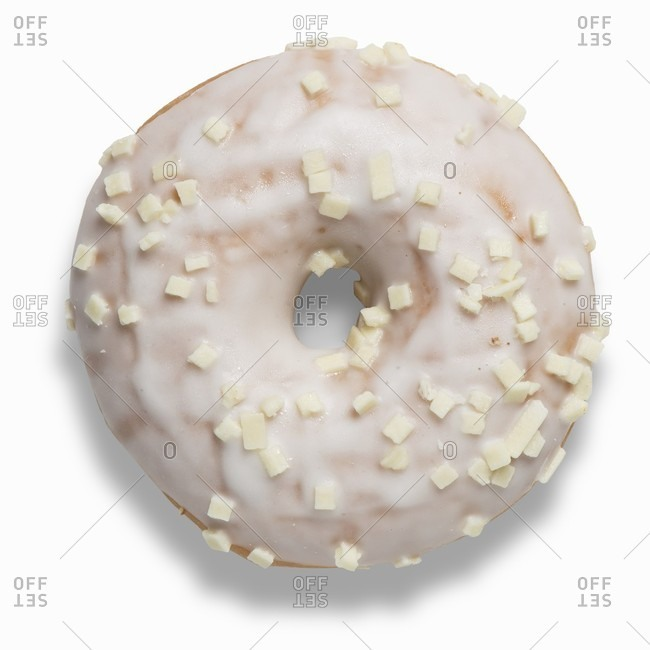 A doughnut with white chocolate glaze and white chocolate pieces