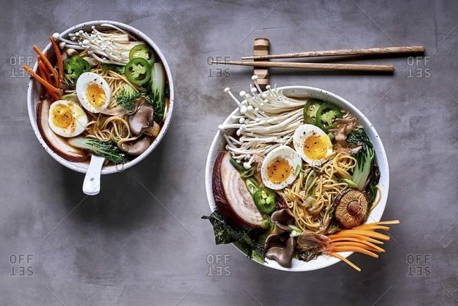 Ramen noodle soup with mushrooms, vegetables, pork belly and egg