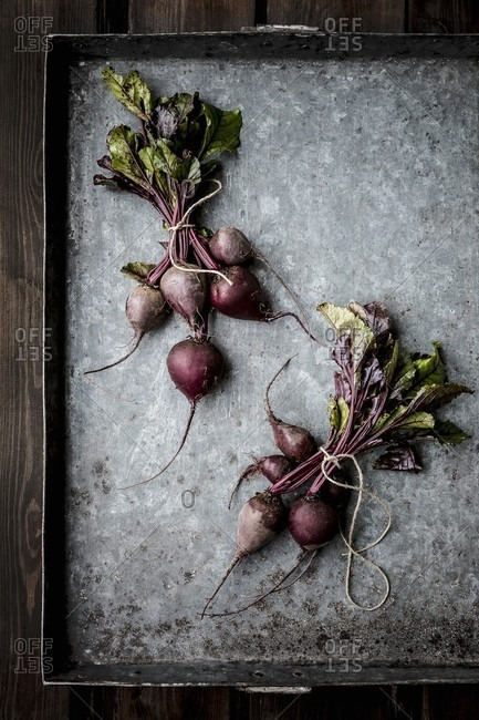 Bundles of beetroot on a baking tray