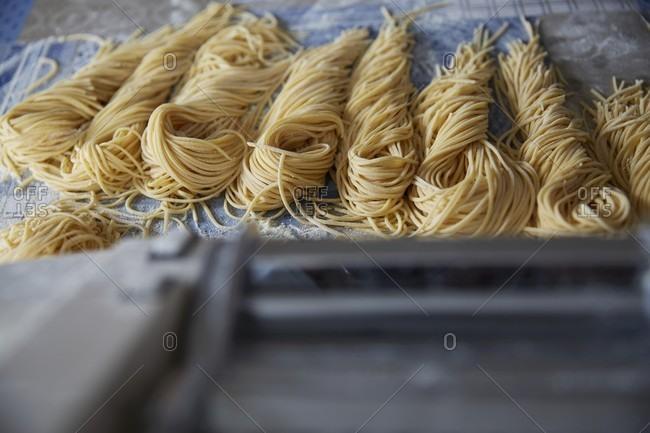 Fresh spaghetti on a tea towel