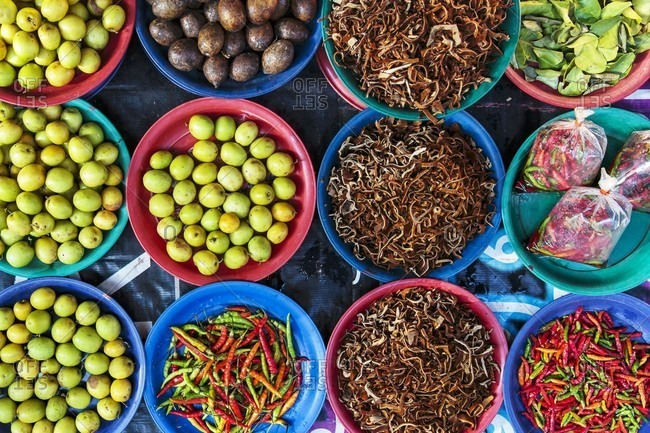 Wild mushrooms, golden plums and chili at a market in Vientiane, Laos