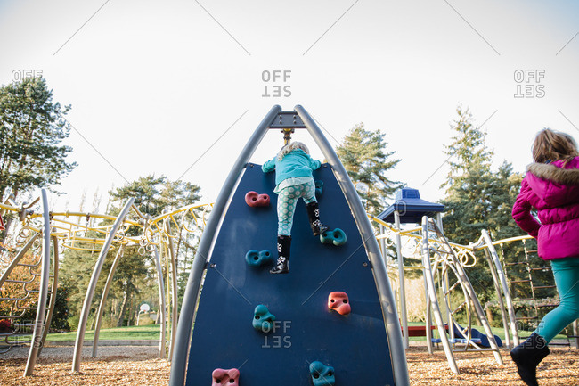 Girl climbing on playground structure