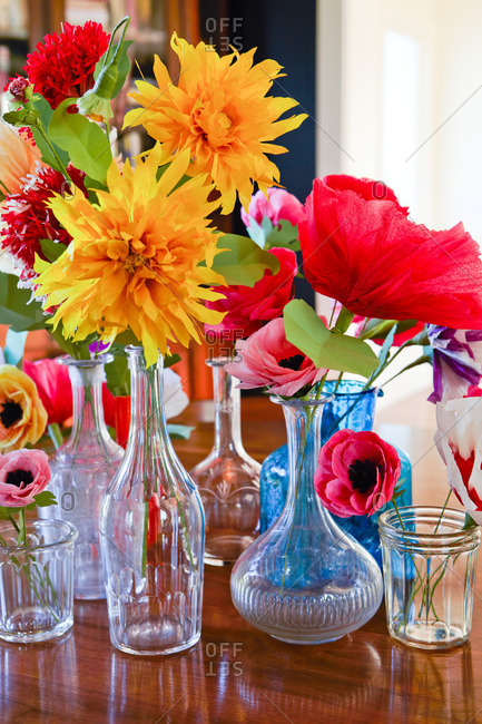 Vases filled with colorful paper flowers