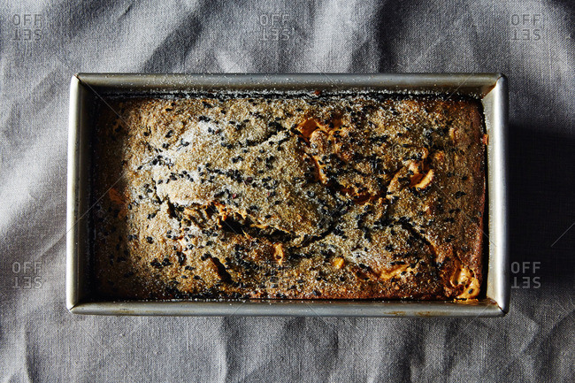 Sesame loaf cake in pan