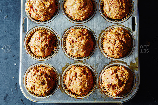 Muffins with almonds in pan