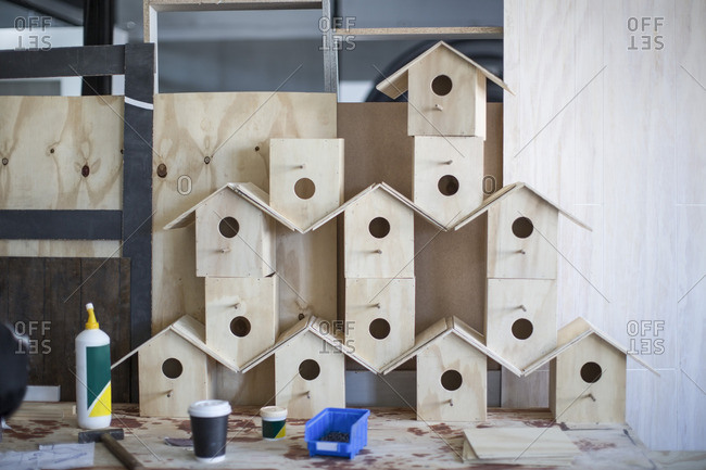 Stacked birdhouses in workshop
