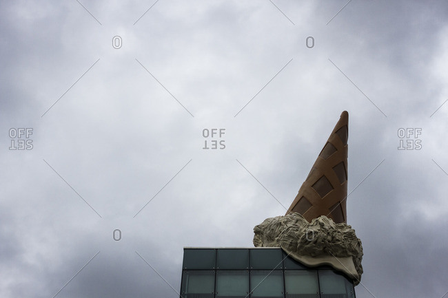 Cologne, Germany - October 14, 2012: Ice cream cone sculpture atop a building in Cologne, Germany
