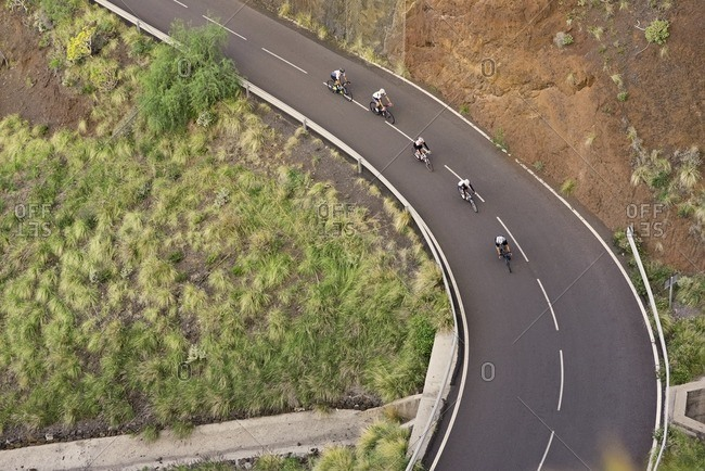 Group of cyclists descending a steep hill