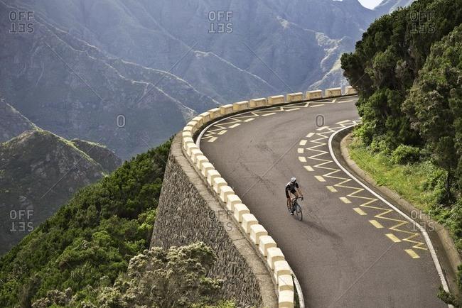 Cyclist descending a steep hill