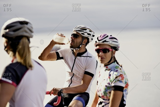 Group of cyclists taking a water break