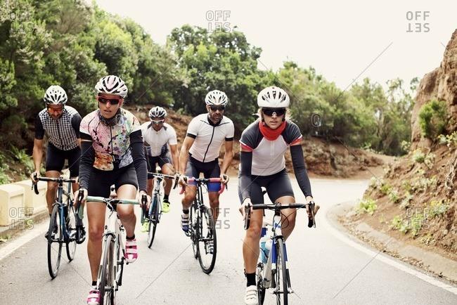Cyclists descending a hill