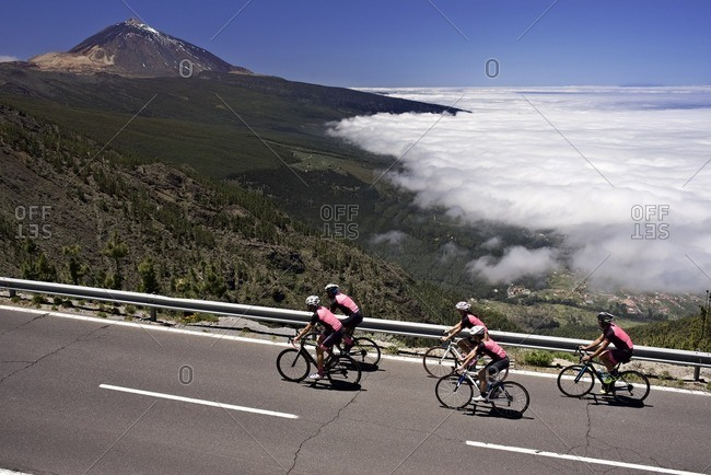 Group of cyclists riding along a mountain road