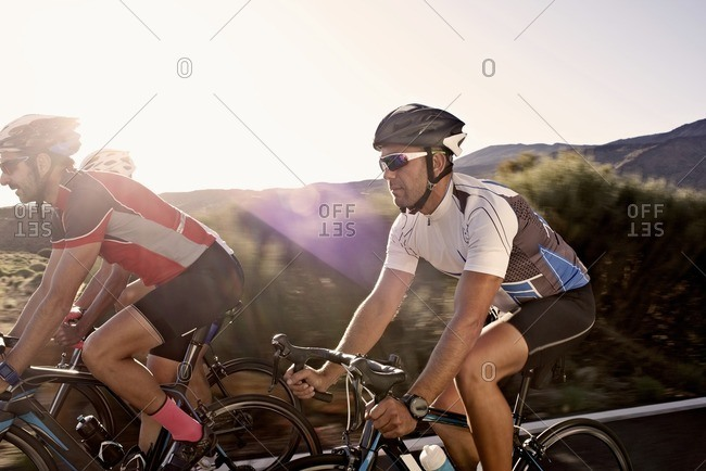 Close-up of three cyclists riding side-by-side