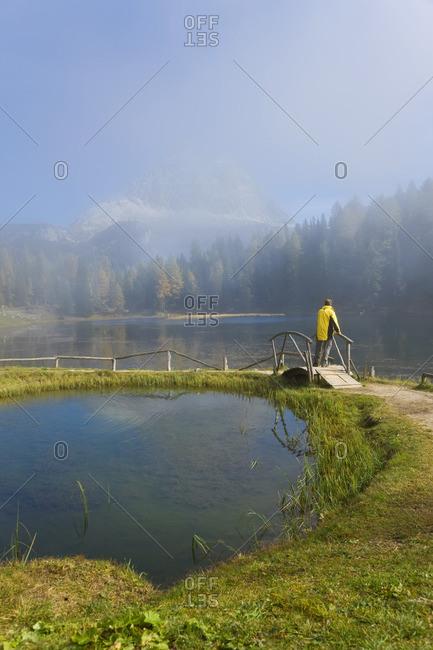 Man on lake path, Italy