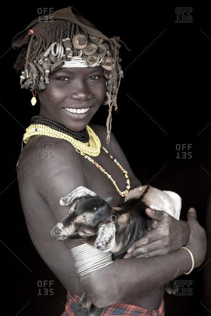 Omo Valley, Ethiopia - January 26, 2009: Dassenech girl with goat, Omo Valley, Ethiopia