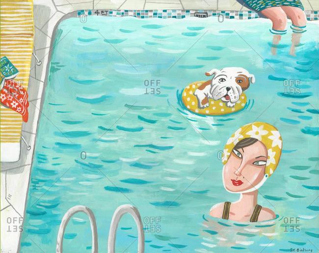 Woman and bulldog swimming in pool
