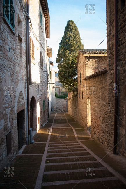 Narrow street between houses in Assisi, Italy