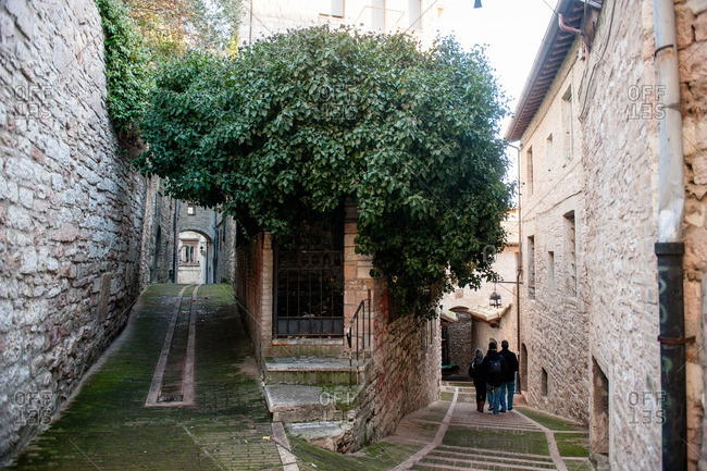 Family waking down steps in Assisi, Italy