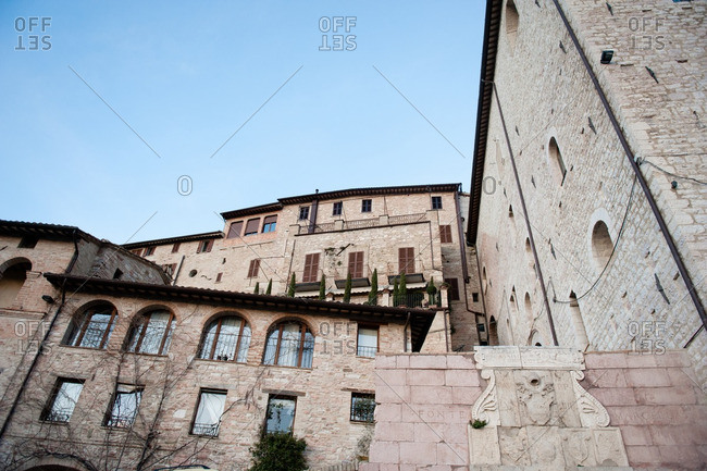 Looking up at historic buildings in Assisi, Italy