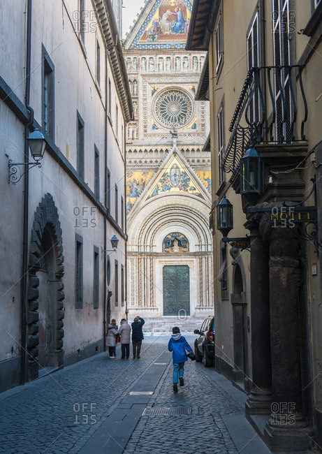 boy running towards Duomo of Orvieto