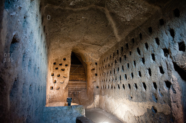Carved pigeon holes in underground chamber in Orvieto, Italy