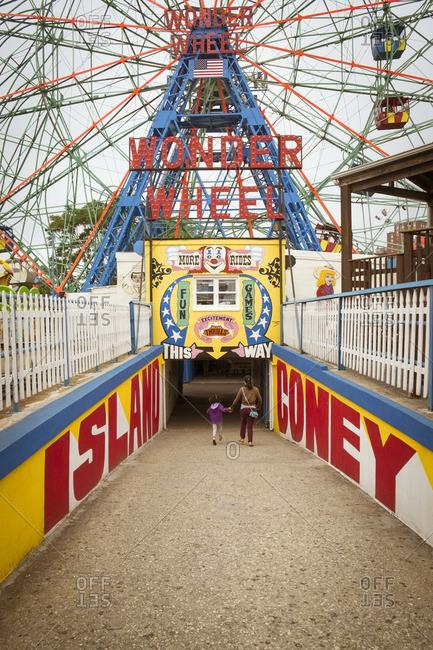Coney Island, Brooklyn, New York - June 9, 2016: People walking to Coney Island Ferris wheel