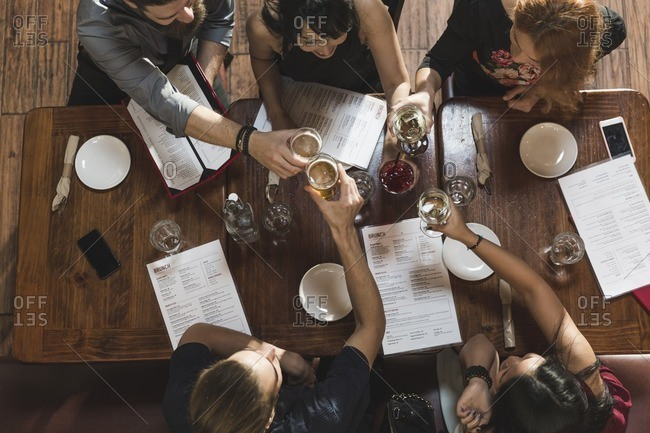 Group of friends toasting in a restaurant