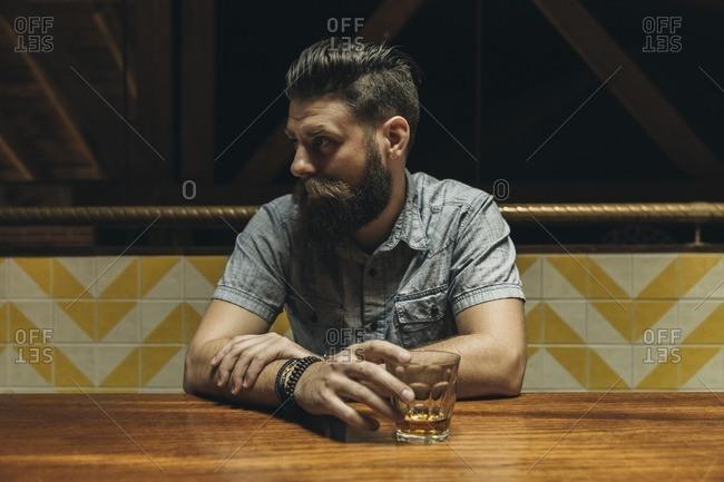 Man drinking liquor in a bar