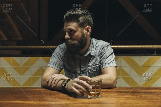Man drinking liquor in a bar