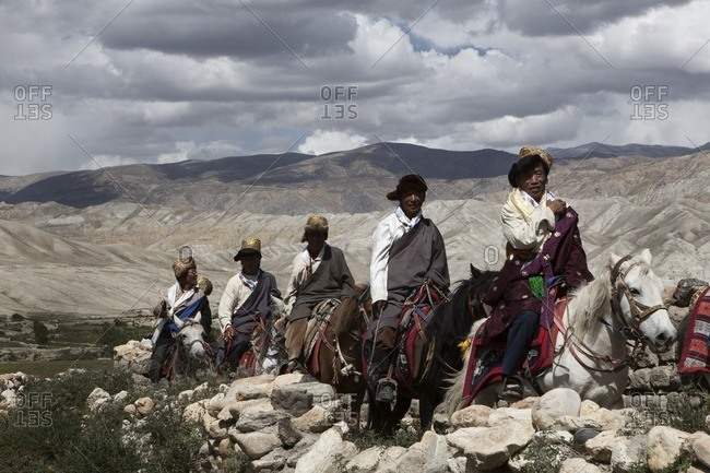 Lo Manthang, Mustang, Nepal - August 20, 2015: Villagers from Lo Manthang and surrounding areas make their way to the open fields during the Yartung Festival