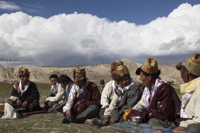 Lo Manthang, Mustang, Nepal - August 20, 2015: : Group of villagers from Lo Manthang  gathered in a field for the Yartung Festival