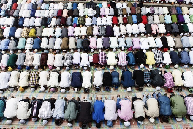Muslims bowing at the Eid Al Fitrl celebration at Kashmiri Mosque in Kathmandu, Nepal