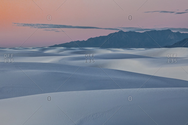 Sunset afterglow and twilight dunes in White Sands National Monument