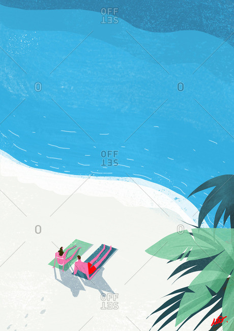 Couple sunbathing by the ocean