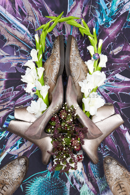 Neutral colored shoes on a graphic floral background